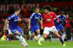 Manchester United midfielder Marouane Fellaini makes a move on a Chelsea defender. The game ended at 1-1 deadlock.