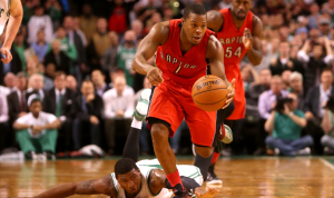 National Basketball Association: Toronto Raptor's point guard Kyle Lowry breaks away from the Boston Celtics defence for an easy layup. Lowry finished the game with 35 points and the Raptors won 110-107.