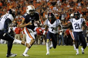 College Football: Auburn Tigers quarterback Nick Marshall picks apart the Mississippi Rebels defence with his legs. Auburn won the game Saturday evening, rocketing the program to third in the country. Ole Miss lost their second game in a row to drop to eleventh in the country.