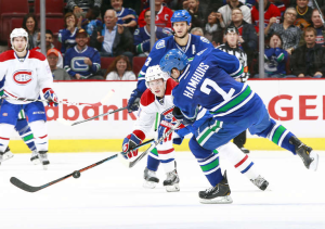 National Hockey League: Vancouver Canucks' defenceman Dan Hamhuis lets a slapshot go from the point. The Canucks won 3-2 in overtime over the Montreal Canadiens.