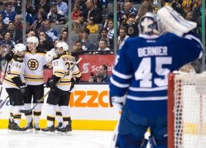 Toronto goaltender Jonathan Bernier looks on as Dougie Hamilton celebrates his third period goal. The Bruins won 4-1.