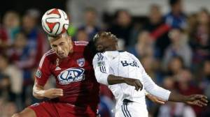 Players from FC Dallas and the Vancouver Whitecaps battle for a header. Dallas won on a late game goal.