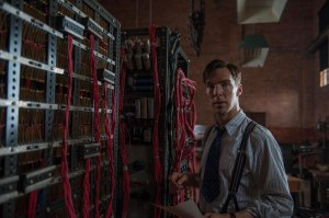 "Alan Turing (Cumberbatch) and his machine ""The Bomb""."